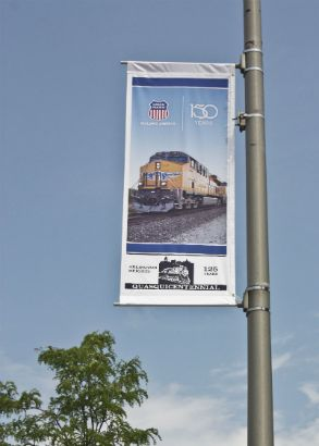 Union Pacific Arlington Heights.  Avenue banner announcing an anniversary.
