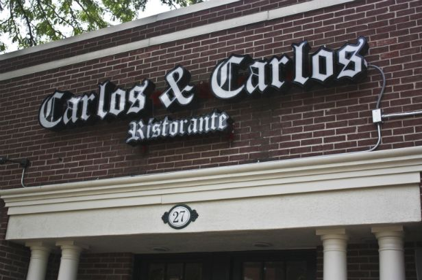 Carlos & Carlos Arlington Heights.  LED lighted channel letters on a raceway.