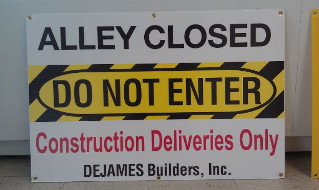 DeJames Construction Inc.  Informational temporary Cor-x construction signs with brass grommets for hanging on fence.