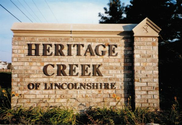 Heritage Creek Lincolnshire. Dimensional bronze letters, stud mounted in brick.
