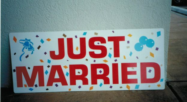 Just Married sign.  Confetti effect in the back makes for an exciting and colorful announcement.