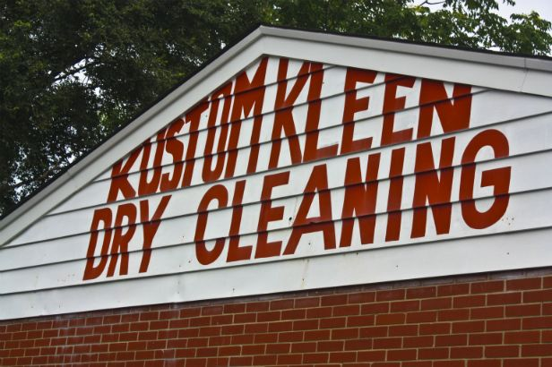 Kustom Kleen Dry Cleaning Arlington Heights.  This unique vinyl application on the building's siding is a creative way to get the most out of your advertising space for a low cost!