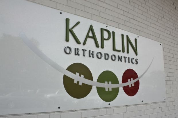Kaplin Orthodontics Arlington Heights.  Aluminum panel with dimensional acrylic letters make this sign unique and durable.