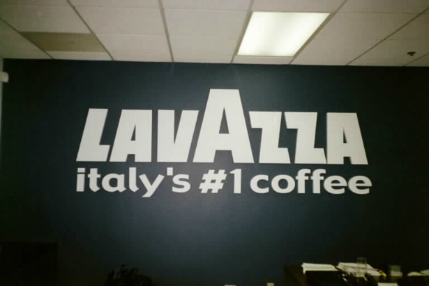 Lavazza.  4ft high by 10ft wide in the lobby.
