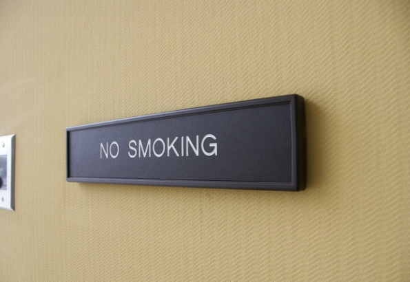 "Plastic ""No smoking"" sign with dimensional frame."