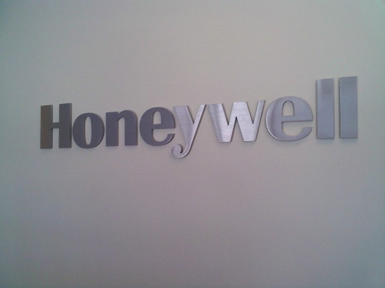 Honeywell.  Dimensional acrylic logo with brushed silver metal laminate face.