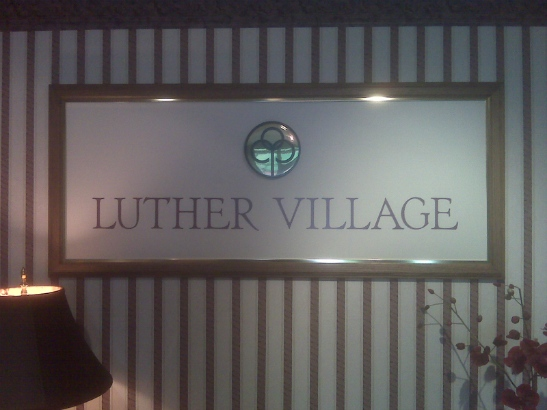 Luther Village.  Custom frame with logo and lettering.