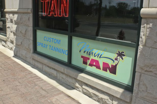Maui Tan Arlington Heights.  Colorful logo with gradient pattern in text.