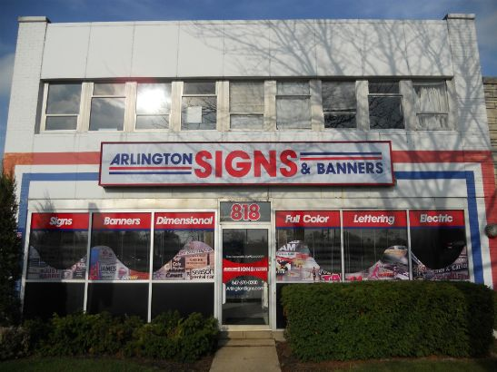 Arlington Signs and Banners.  We combined graphic images with solid bands of text.  Combining products makes for an effective and eye catching storefront.