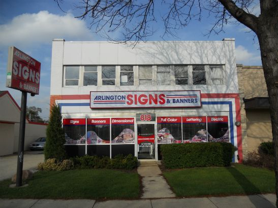 Arlington Signs and Banners.  We combined graphic waves of colorful images, solid bands of text and two lighted signs to create a visually stunning storefront and stand out from the rest.