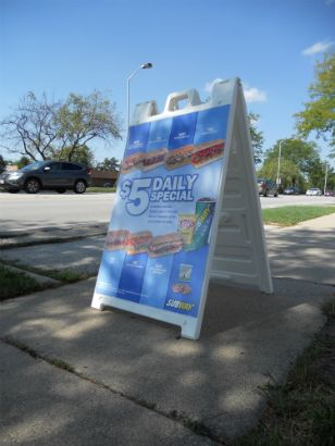 Sidewalk sign advertising the daily deals.