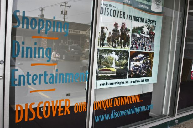 Discover Arlington.  Combine window lettering with banners for a multi-layered low cost storefront display.