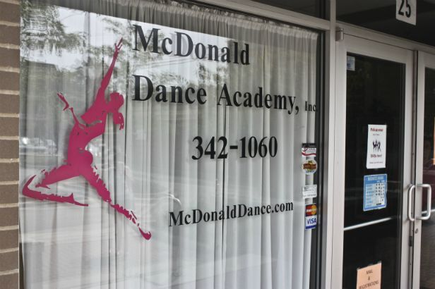 McDonald Dance Academy Arlington Heights.  A vivid logo stands out on the glass.
